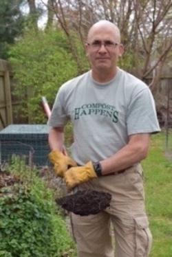 The author savoring the earthy smell of finished compost.
