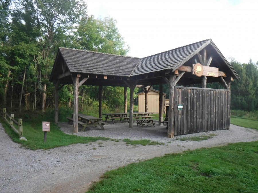 large wooden picnic pavilion with tables