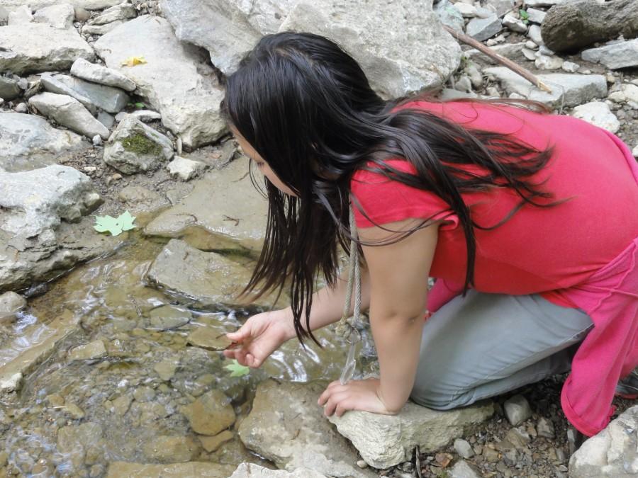 girl playing in stream